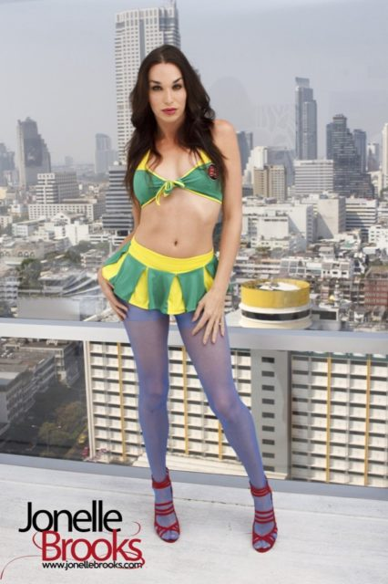 Jonelle Brooks XXXBios - TS Jonelle Brooks in sexy yellow and green lingerie, stockinhs and red high heels - TS Jonelle Brooks porn pics